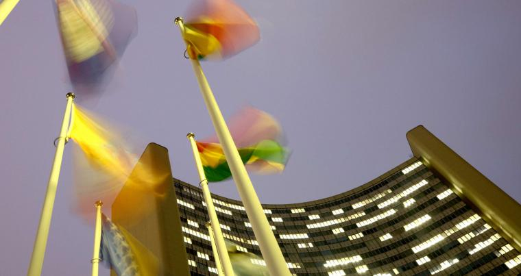 Flags flutter in the wind in front of the headquarters of the International Atomic Energy Agency (IAEA) in Vienna, Austria, December 16, 2020. (Reuters)