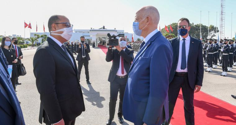 Prime Minister Hichem Mechichi greets President Kais Saied, on November 16, 2020, at Tunis Carthage airport as he returns from a trip abroad.  (Presidence.tn)
