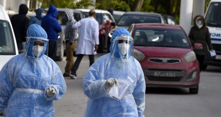 Members of the intensive care unit medical team walk in front of the Ariana Abderrahmen Mami hospital, in the city of Ariana near the Tunisian capital Tunis on January 27, 2021. (AFP)
