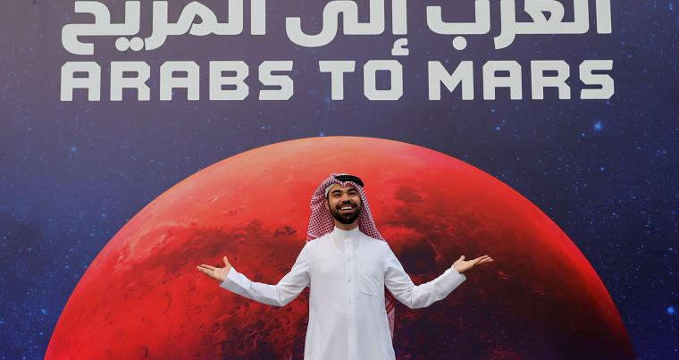 An Emirati arrives at an event to mark Hope Probe's entering the orbit of Mars, in Dubai, United Arab Emirates, February 9, 2021. (REUTERS)