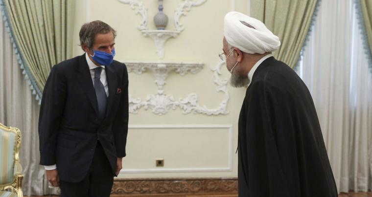 A 2020 file photo shows Iranian President Hassan Rohani, right, receiving Director General of International Atomic Energy Agency Rafael Mariano Grossi in Tehran, Iran. (AP)