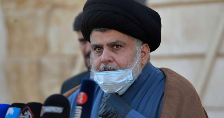 Iraqi cleric Moqtada al-Sadr delivers a statement in a rare press conference outside his home in Iraq's holy city Najaf, on February 10, 2021. (AFP)