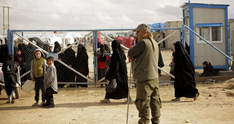 A file picture shows a Kurdish guard at Al-Hol camp, at the gate to the section where foreign families from Islamic State-held areas are housed, Hassakeh province, Syria. (AP)
