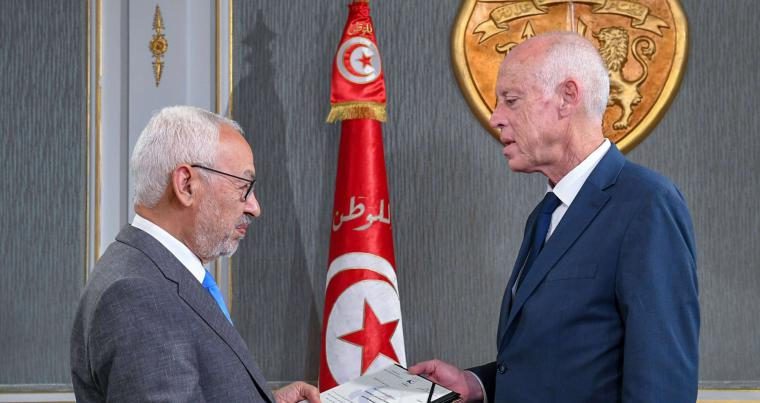 A 2019 file picture shows Tunisia's President Kais Saied (R) receiving Ennahdha leader and parliament speaker Rached Ghannouchi at the presidential palace in Carthage. AFP