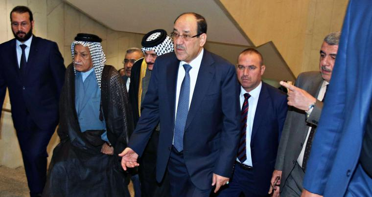 A file picture shows former Iraqi Prime Minister Nouri al-Maliki, centre, arriving at the parliament building, in Baghdad, Iraq. (AP)