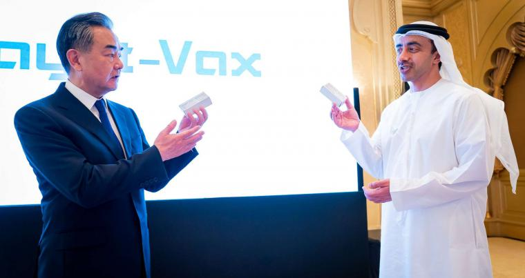 China's Foreign Minister Wang Yi and UAE's Foreign Minister Abdullah Bin Zayed Al Nahyan show the Chines made coronavirus (COVID-19) vaccine (WAM).