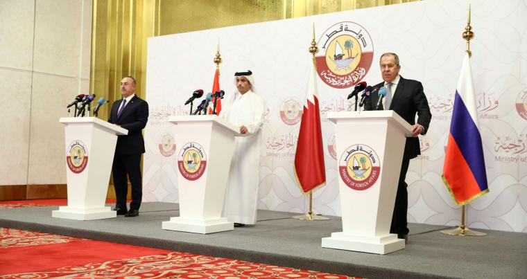Qatar'sMinister of Foreign Affairs Mohammed bin Abdulrahman Al Thani, Russia's Foreign Minister Sergei Lavrov and Turkey's Foreign Minister Mevlut Cavusoglu speak  in Doha,  March 11, 2021. (REUTERS)