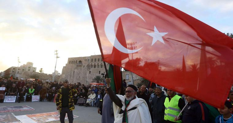 Demonstrators wave a large Turkish flag as they take part in a rally in Martyrs' Square in the capital Tripoli on January 10, 2020. (AFP)