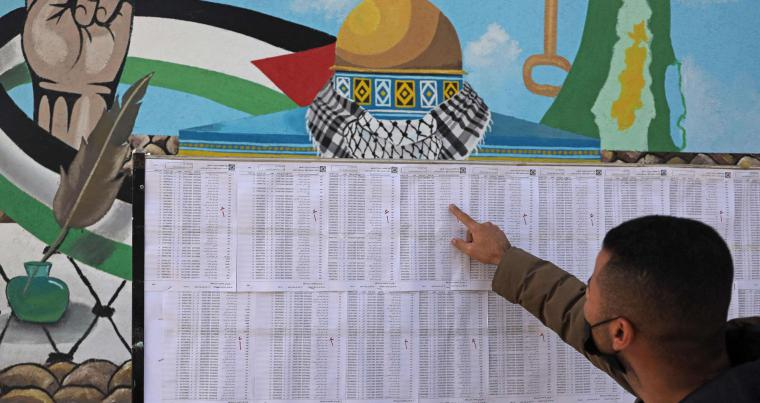 A Palestinian man looks for his name on the electoral roll at a school in Gaza City. (AFP)