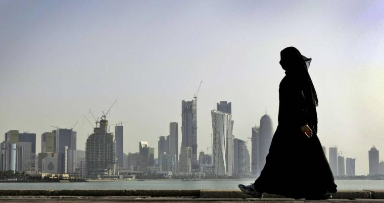 A file photo shows a woman walking in Doha, Qatar where HRW is urging greater female freedoms. (AP)