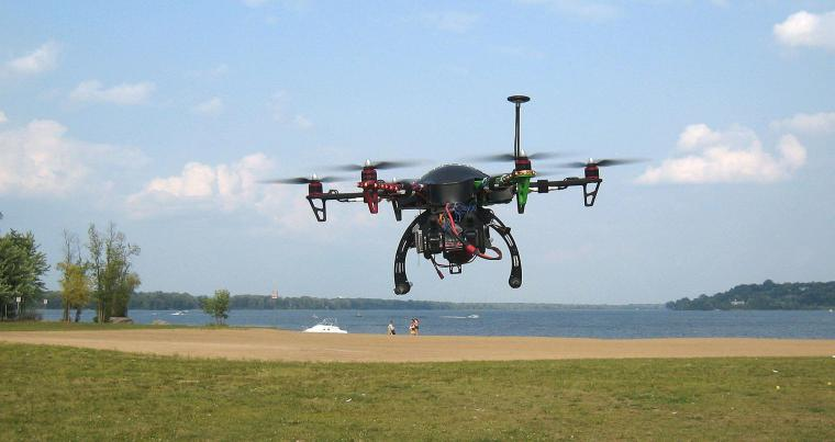 A drone hovers over Petrie Island park in Ottawa, Canada. (REUTERS)