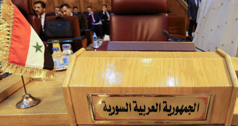 The empty seat of the Syrian delegation during an Arab League meeting to discuss the Syrian crisis in Cairo. (REUTERS)