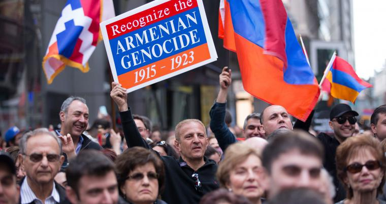 A file picture shows a demonstrator holding a sign during a rally to commemorate the 1915 Turkish massacre of Armenians in Times Square in New York City. (AFP)