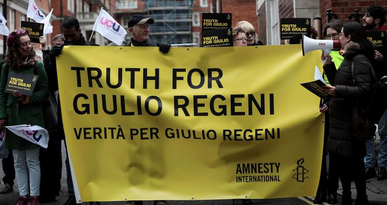 "Demonstrators hold placards outside the Egyptian embassy calling for ""the truth"" in Giulio Regeni's murder. (REUTERS)"