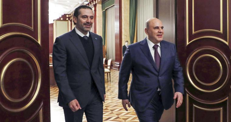 Russian Prime Minister Mikhail Mishustin, right, and Lebanese Prime Minister-Designate Saad Hariri enter a hall for their talks in Moscow, Russia, April 15, 2021. (AFP)
