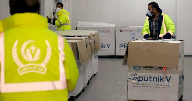 Workers unload a shipment of Russia's Sputnik V vaccine against the coronavirus disease (COVID-19), in Tripoli, Libya, April 4, 2021. (REUTERS)