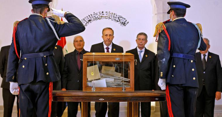 The Supreme Constitutional Court, the highest jurisdictional authority in Syria, receives the ballot box of the country's Parliament members in the capital Damascus, on April 29, 2021.(AFP)