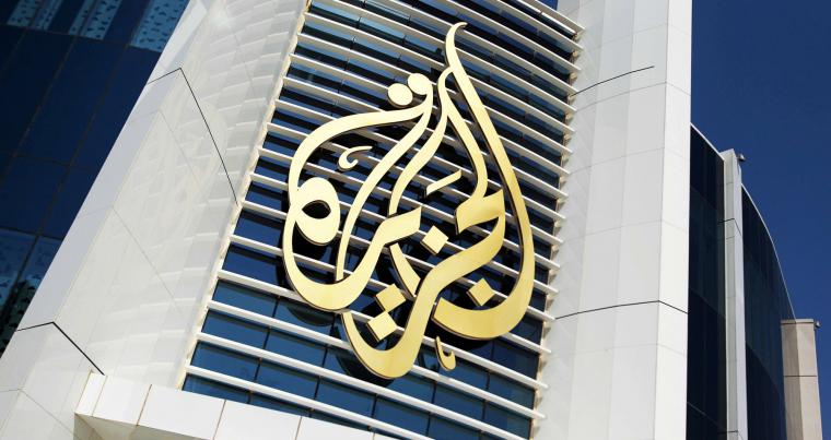 The logo of Al Jazeera Media Network is seen on its headquarters building in Doha. (REUTERS)