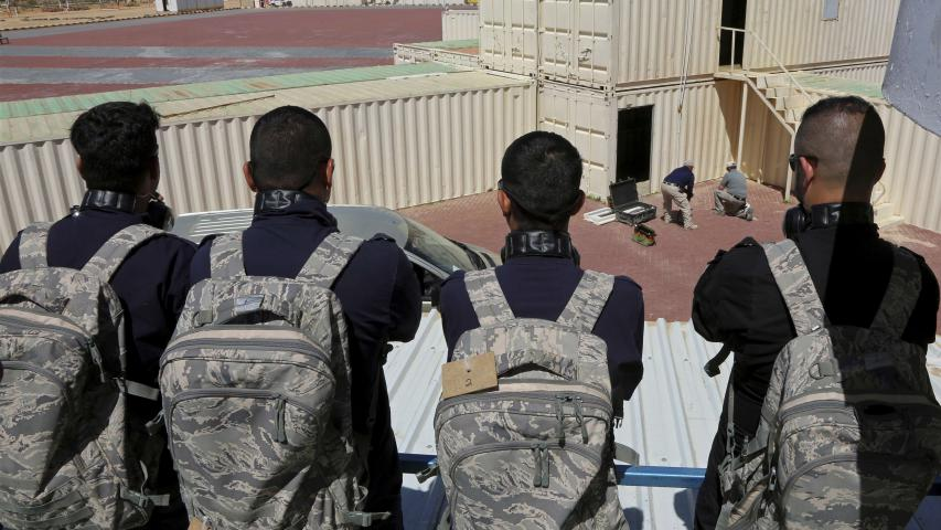 A SWAT team from Iraq's Anbar province watches US instructors staging a training drill on how to respond to a bomb threat and how to detonate the device at the Jordan International Police Training Centre, in the Jordanian town of al-Muwaqqar, about 55km south-east of Amman, on March 18. (AP)