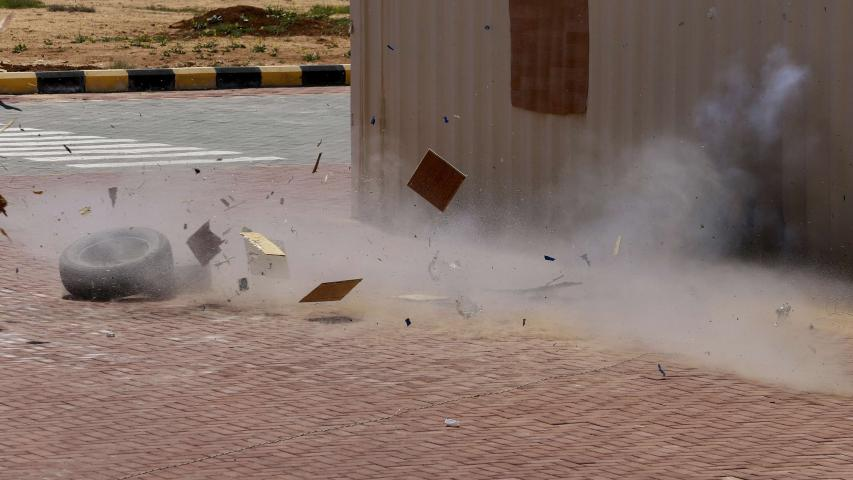 A mock bomb is detonated during a training drill on how to respond to a bomb threat and how to detonate the device at the Jordan International Police Training Centre, in the Jordanian town of al-Muwaqqar, about 55km south-east of Amman, on March 18. (AP)