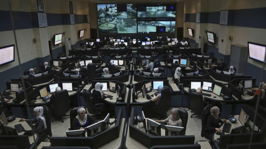 Jordanian call-takers and dispatchers are seen at Jordan's 911 emergency call centre in Amman on March 20. (AP)