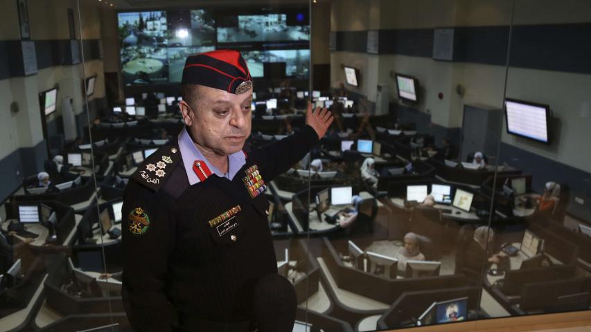 Brig. Rami al-Dabbas, the head of Jordan's Command and Control Centre, explains the operations of the national 911 emergency call centre, which receives thousands of calls a day, in Amman, on March 20 (AP)