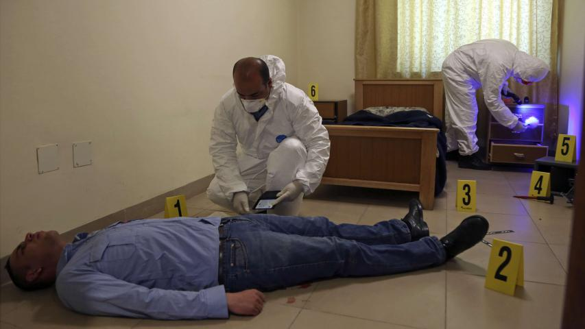 Jordanian crime scene technicians dust for fingerprints as part of a drill held at the nation's Forensic Science Laboratory, in Amman, on March 19. (AP)