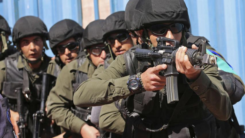 Palestinian security forces participate in a training drill on how to retake a police station that has come under attack, at the Jordan International Police Training Centre, in the Jordanian town of al-Muwaqqar, about 55km south-east of Amman, on March 18. (AP)